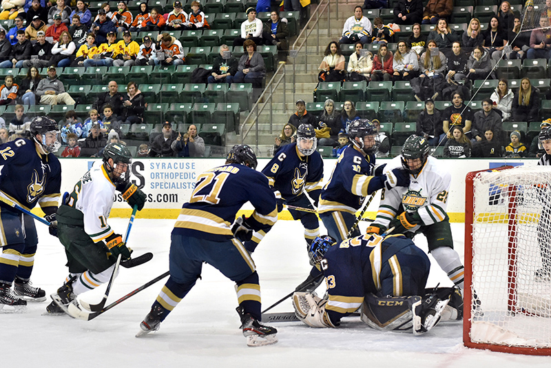 Men's hockey forwards senior Michael Gillespie (#16) and sophomore Travis Broughman (#28) pressure Canton's defense during an 8-2 win for the Lakers