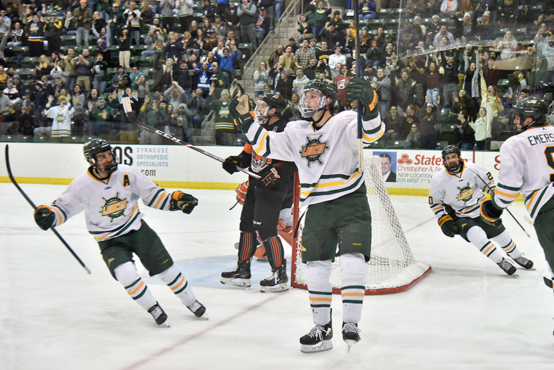 Oswego men's freshman hockey forward Alex DiCarlo (#23), center, celebrates his goal Feb. 21 in the third period against Buffalo, leading to a 3-2 Laker win