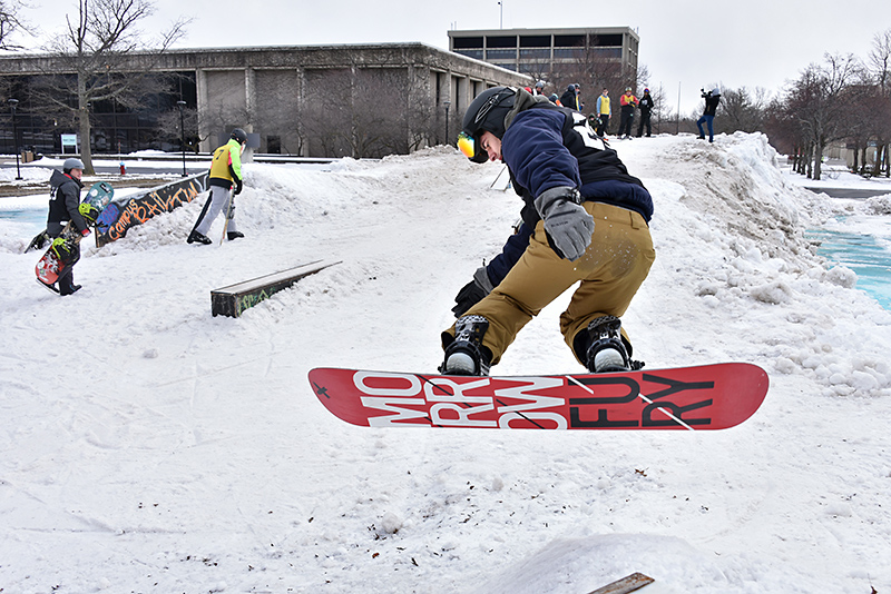 The annual Rail Jam, hosted by the Oswego Ski and Snowboard Club, had a fresh supply of lake-effect snow for its friendly competition on Feb. 28 on the academic quad. Here snowboarder Chris Hallock catches some air.