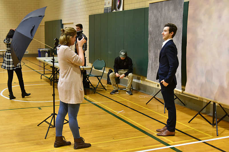 David Hite, a senior dual major in broadcasting and mass communication and in philosophy, gets a professional-looking photo taken at the March 4 Career and Internship Fair photobooth