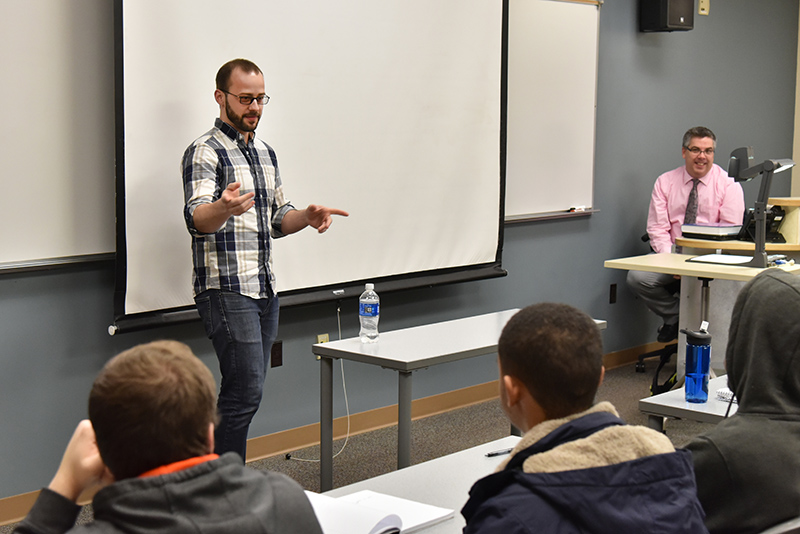 "David Greco, a 2013 SUNY Oswego alumnus and operations manager for Saratoga Performing Arts Center/LiveNation, speaks March 9 to the ""Operations Management"" class"