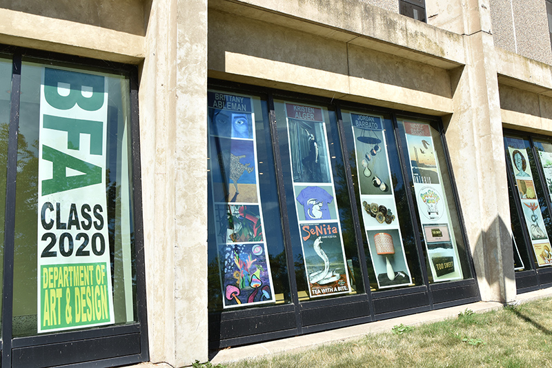 The BFA exhibition for bachelor of fine arts spring 2020 graduates appears as posters of student art lining the windows of Tyler Hall.
