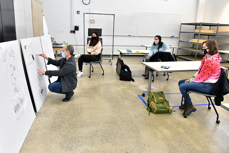 Art faculty member Richard Metzgar leads a critique of his students' experimental work during a class in 2-D design in Tyler Hall.