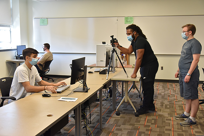 """Technology education students in Mark Springston's """"Communication and Media Systems"""" class worked on a documentary depicting student, academic and campus life in the era of COVID-19."""
