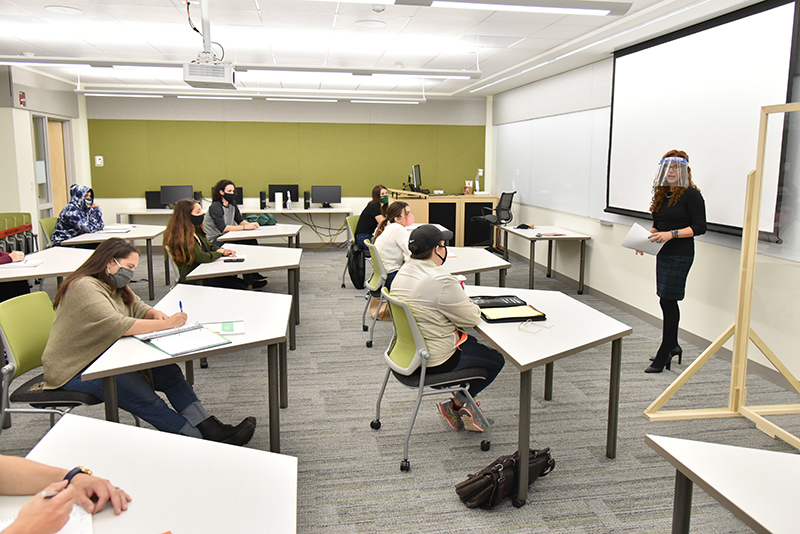 Jodi Mullen of the counseling and psychological services faculty leads a class in a renovated section of Wilber Hall.
