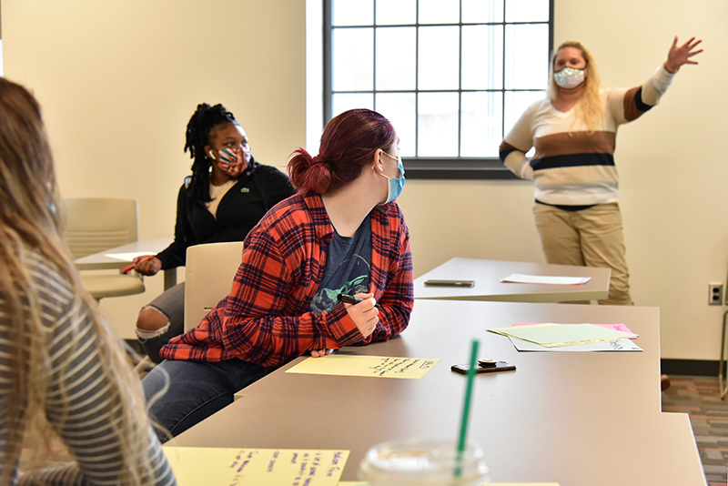 """Students participate in discussions during a """"Sexual Health in the Media"""" class in Park Hall by Jessica Harris (pictured at right) of the health promotion and wellness department."""