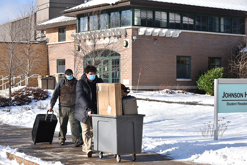 Cabot Wiggett, a freshman, moves into Johnson Hall with help from his dad Jan. 24, the first day of the week-long period scheduled for students to settle into their campus rooms.