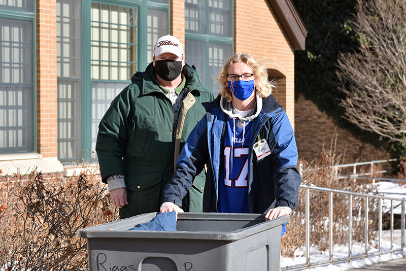 Ray Paull, a sophomore and ardent Buffalo Bills fan, moves into Riggs Hall with help from his dad on Jan. 24.