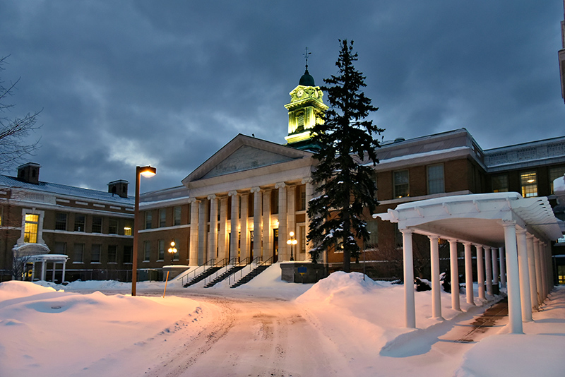 An Oswego winter evening with snow Feb. 14 reflects the aesthetic of classic architecture found in Sheldon Hall.