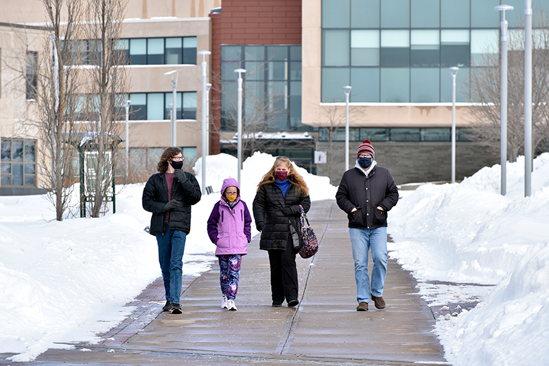 Prospective student Kyle Schnauffer (left), from Chittenango, checks out the campus with his parents and sister.