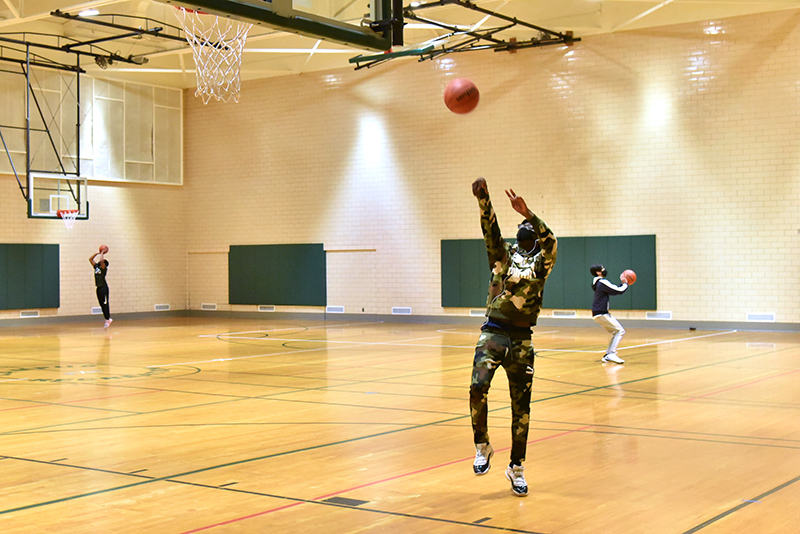 Jamal Brown, a freshman adolescence education major, advances toward the basket in Swetman Gymnasium, which Campus Recreation has open for a variety of uses in accordance with health protocols.