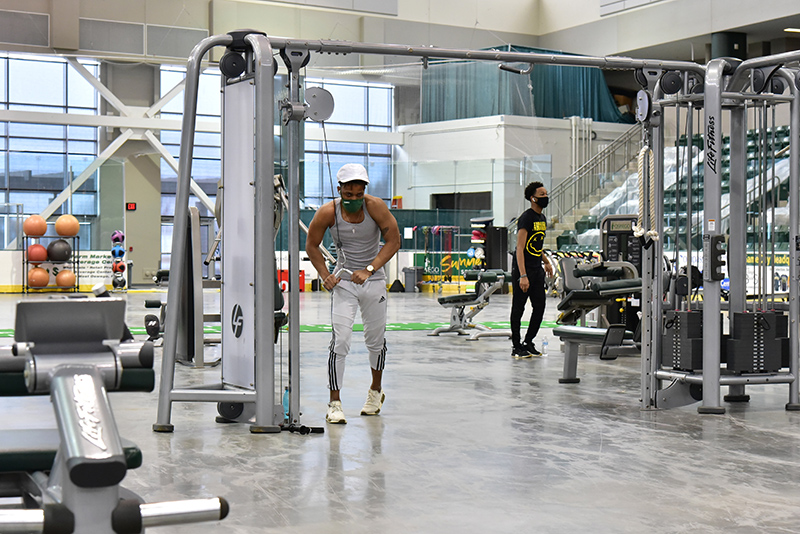 Tyreek Trapp, a junior finance major, works with exercise equipment in the Fitness Centers in Marano Campus Center arena during the Feb. 24 Wellness Day.