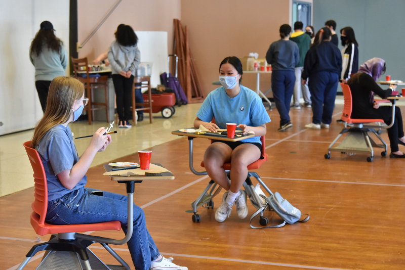 A March 23 Wellness Day event offered to Paint Your Stress Away in Hewitt Ballroom, where participants could choose from a variety of items to paint with provided supplies. Painting colors onto shapes cut from wood are Grace Clayton (left), a freshman computer science major, and Sarah Krueger, a freshman marketing major.