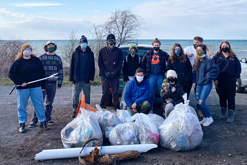 Sustainability students and volunteers are pictured April 22 with some of the litter they collected along the Lake Ontario shore during Earth Week.