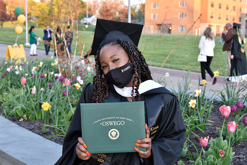 Kerisha Lewis earned her master's in strategic communication at the May 14 Commencement ceremony. Lewis earned her bachelor's from Oswego in 2018 and is now the college's assistant director of student-alumni engagement