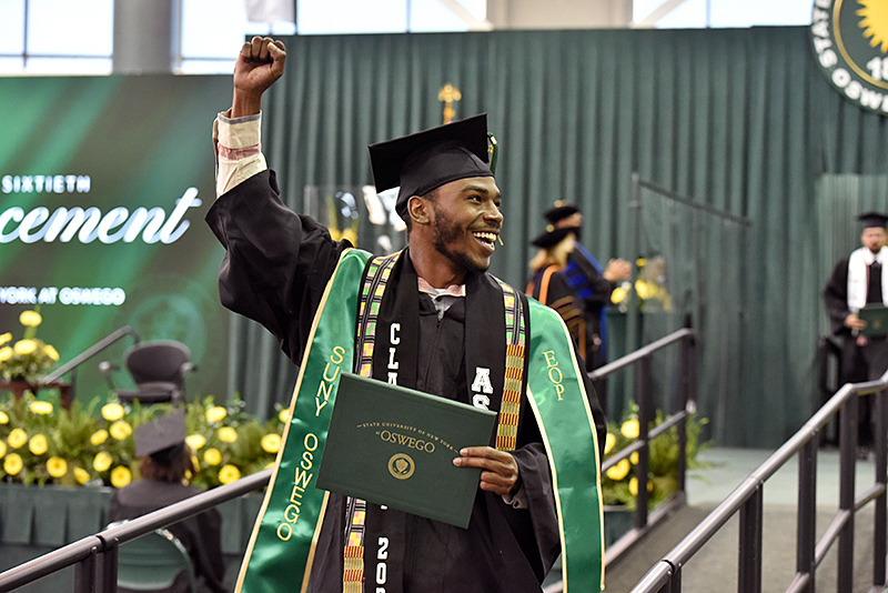 Benjamin Wall gives a jubilant cheer in receiving his diploma May 16 during the 3 p.m. commencement ceremony.