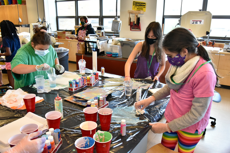 The 42nd annual Sheldon Institute for Barbara Shineman Scholars, designed to address the academic and cultural needs of motivated, inquisitive and creative young students, ran July 19 through 30 on campus. Pictured are students in grades 6-7 and 8-10 expressing their artistic talents during an abstract art painting class taught by Lauren Siskavich.