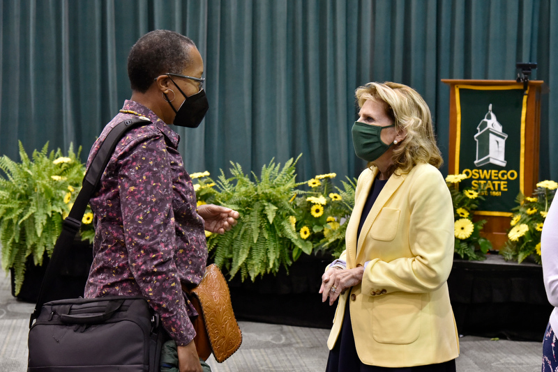 President Deborah F. Stanley (right) speaks after the Aug. 18 Fall 2021 Opening with Jennifer Shropshire, a 1986 alumna, principal for Edward F. Swenson & Associates, Inc., and a very active member of the Oswego Alumni Association Board of Directors, as well as a past board president.