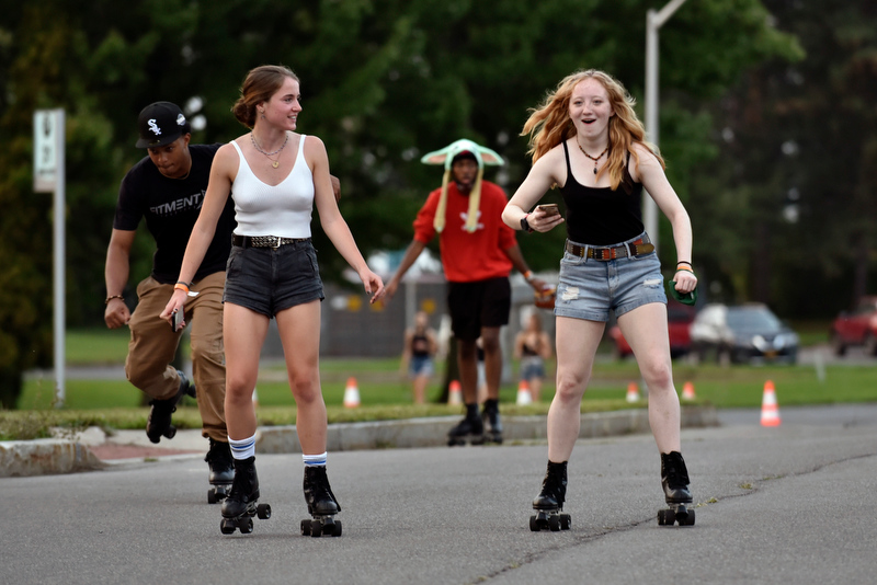 Faith Coyle (left) and Ellen Decker enjoy some advanced roller skating around the parking lot during the Laker Launch Pre-Torchlight Party.