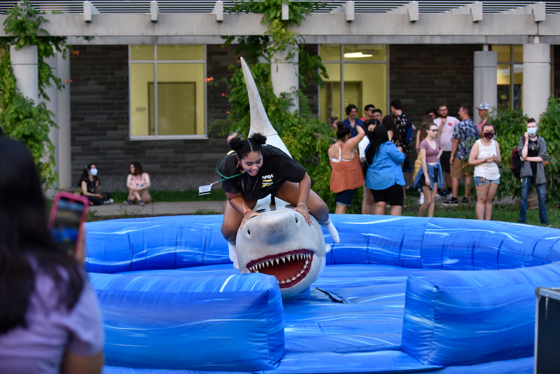 The ever-popular Great White Shark mechanical rodeo ride was challenged by many at the Laker Launch Pre-Torchlight Party.