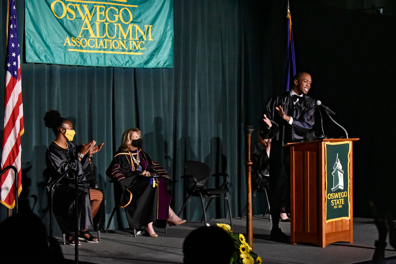 Kamal Morales (at the podium) delivered the student address at Welcoming Torchlight on Friday, Aug. 20.