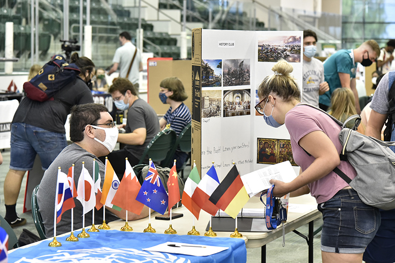 The college's Student Involvement Fair, typically held during the first week of the semester, allows students to explore some of the more than 200 clubs and organizations on campus. Pictured Aug. 25 in the Marano Campus Center arena is History Club member Joseph Falkowski (seated left) talking with Gabrielle Montalbano.