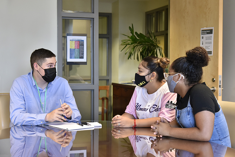 The Advisement Center, which was previously in Hewitt, has a new home in 151 Marano Campus Center (near The Compass) to help students transition academically from high school by providing academic advising, connections to campus resources and academic success workshops. Shown from left are Advisement Guides Eli Holicky, Yadi Aranda Burgos and Dayzja Tyler.