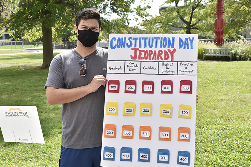 Dylan Lefton, a senior human development major and community services intern, helped to celebrate national United States Constitution Day on Sept. 17 by hosting a table outside Penfield Library offering information and related quiz games.