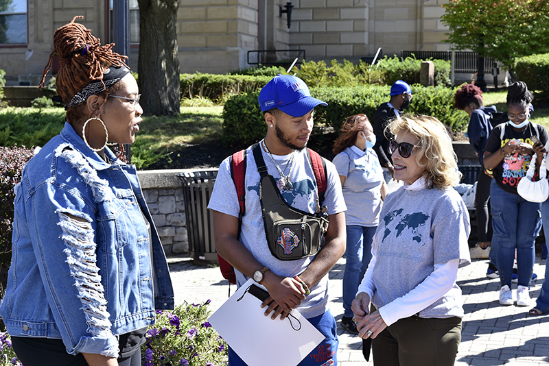 College President Deborah F. Stanley (right) speaks Sept. 26 with poet Jillian Hanesworth and Marquél Jeffries of the college's Institute for Equity, Diversity, Inclusion and Transformative Practices and member of the ALANA Planning Committee, at Oswego City Hall before the ALANA Peace Walk. Hanesworth provided spoken word poetry at the ceremonial beginning of the walk and later during its conclusion at Marano Campus Center.