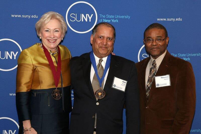 Alok Kumar receiving distinguished professor recognition from SUNY