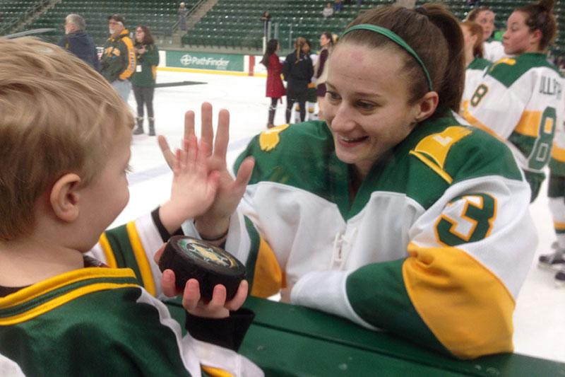 Erika Truschke greeting young fan