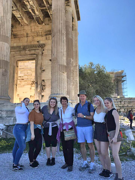 The Athenian Acropolis serves as backdrop for this photo of a group in the study-and-travel course