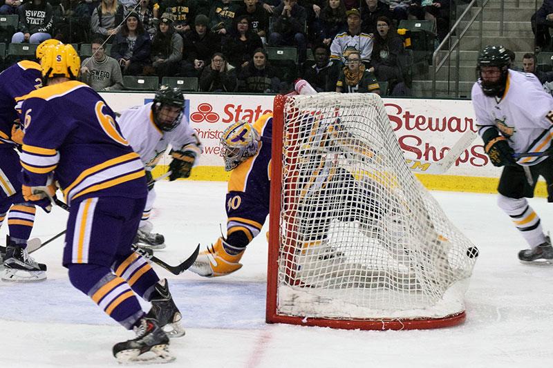 David Ferreira scoring a hockey goal