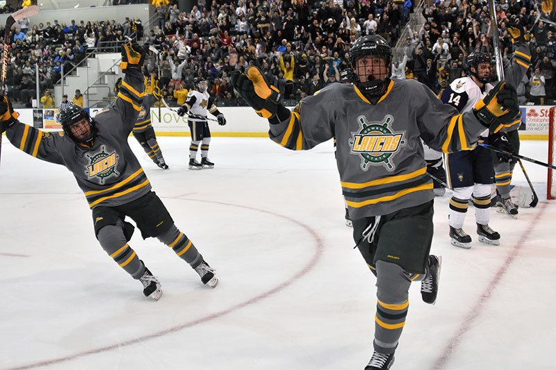 Laker men's hockey players celebrate goal