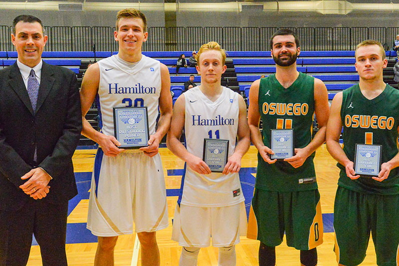 Hamilton All-Tournament Team stands with plaques