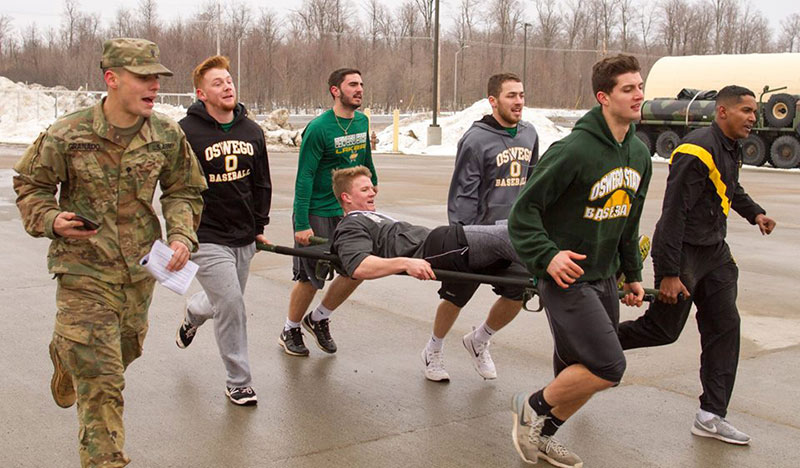 Baseball team training with Fort Drum soldiers