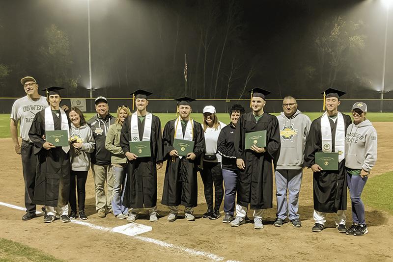 Members of the baseball team celebrate graduation even away at the NCAA tournament