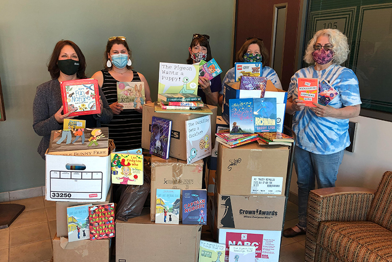 The inaugural SUNY Oswego State Employees Federated Appeal (SEFA) children's book drive netted 717 books for the Oswego Bookmobile. Valued at more than $4,000, the donations will boost the popular program that supports local children ages 3 to 18.