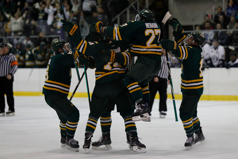 Laker hockey players celebrate goal