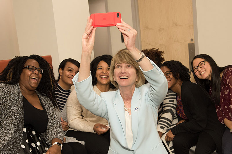SUNY Chancellor Kristina M. Johnson takes photo with education students