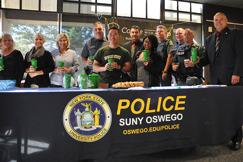 University Police officers, students and staff pause for a photo during Coffee with a Cop