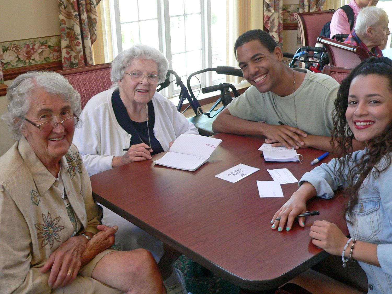 Visiting international students meet with seniors