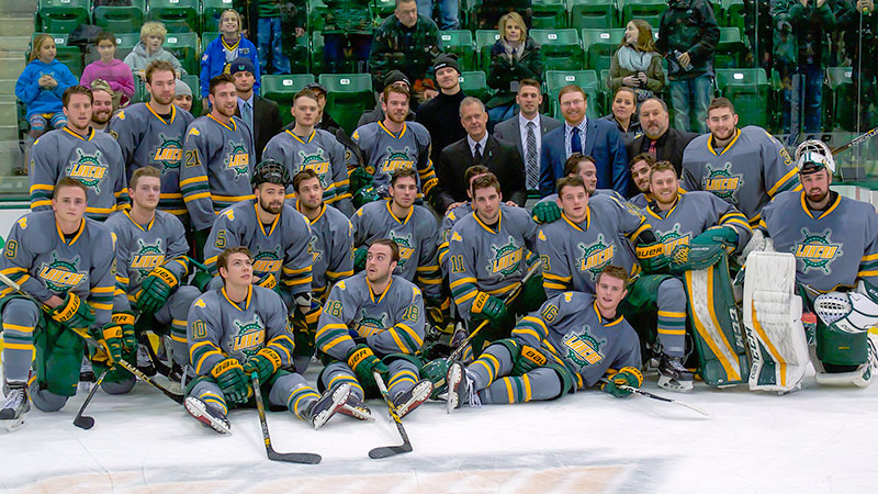 Ed Gosek, surrounded by team, recognized for 300th hockey coaching win