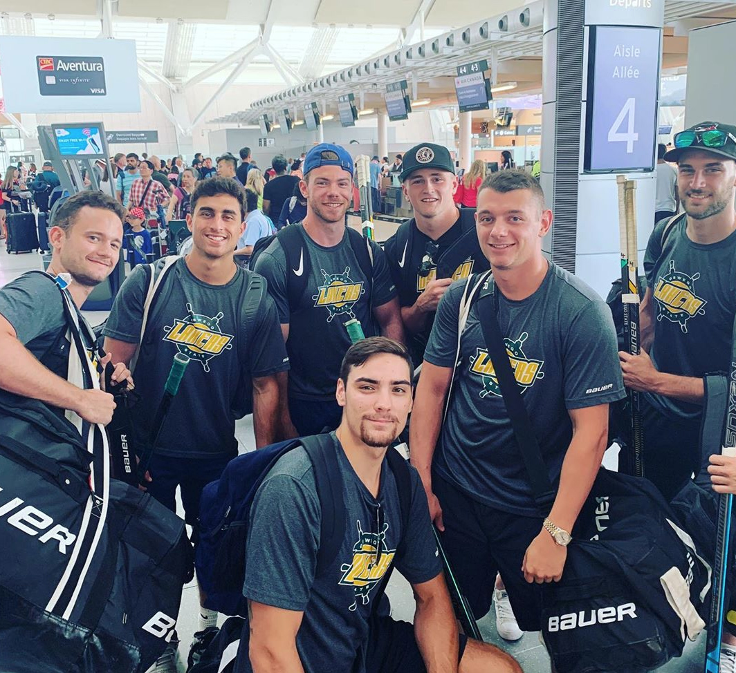 Laker hockey players in an Italian airport