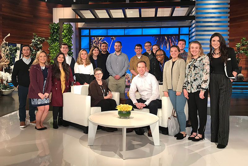 Students the college's annual Hollywood P.O.V. program gather around adviser on set of Ellen show