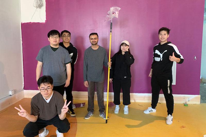 Students help paint children's museum