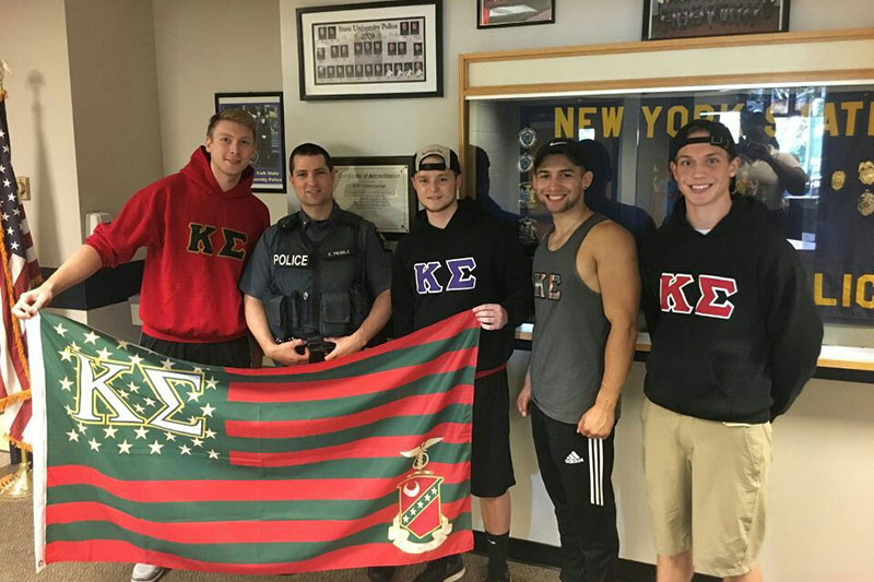 Kappa Sigma fraternity members stop by University Police offices to visit and drop off a thank-you goodie bag
