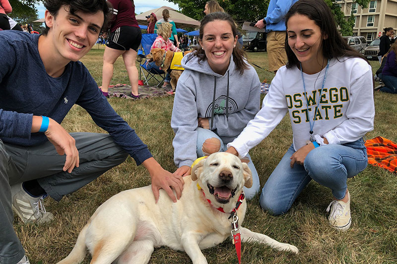 River the dog making students happy, because she's a good dog