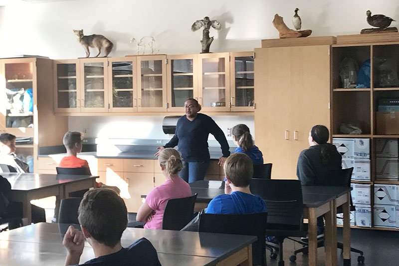 Cayla Turner speaks with about 90 Oswego Middle School students at Rice Creek Field Station