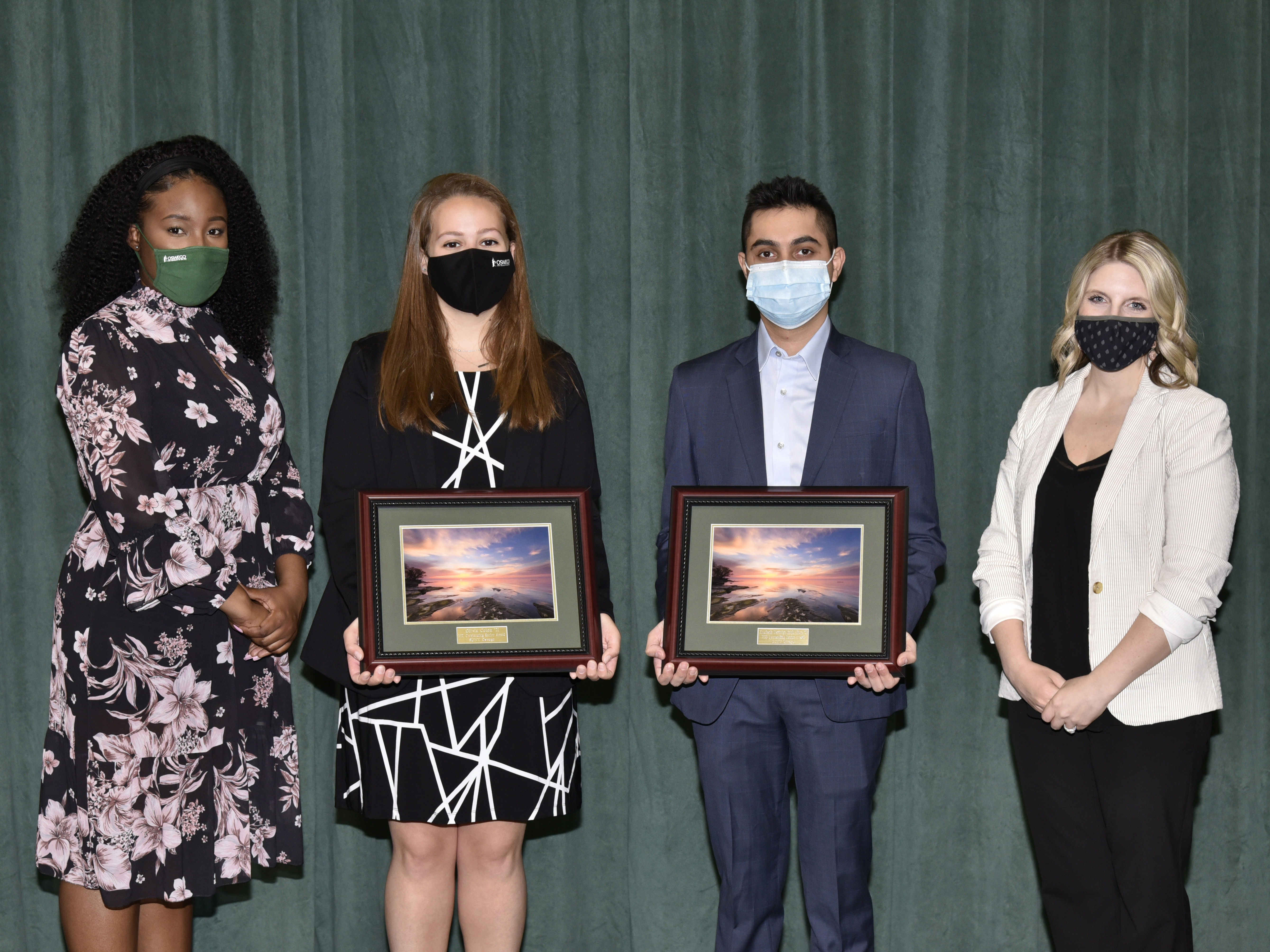 The Oswego Alumni Association's 2021 Outstanding Senior Award recipients Koushank Harinder Singh Ahuja and Olivia Colon (second and third from left) earn congratulations from Kerisha Lewis (left) and Laura Kelly (right) of the college's alumni relations team.